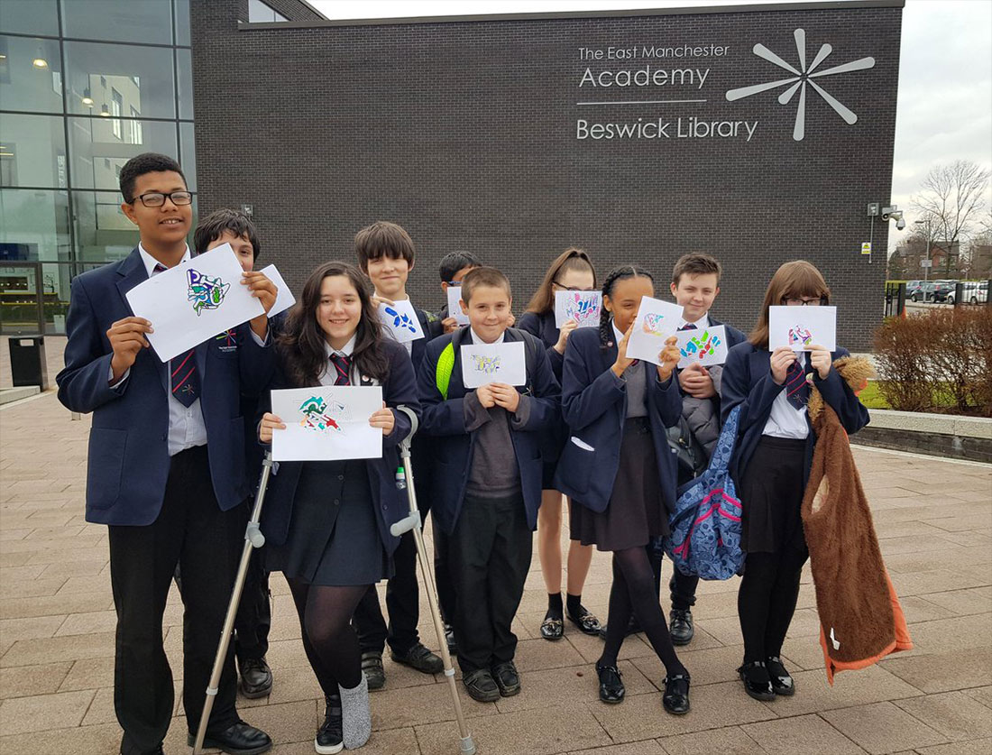 Students displaying artwork created during workshops at the Manchester Art Gallery