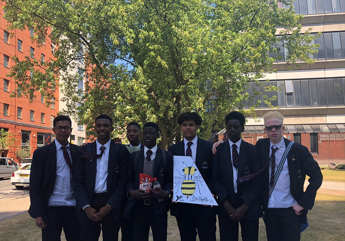 Students outside Manchester Metropolitan University after taking part in the Business Enterprise Challenge