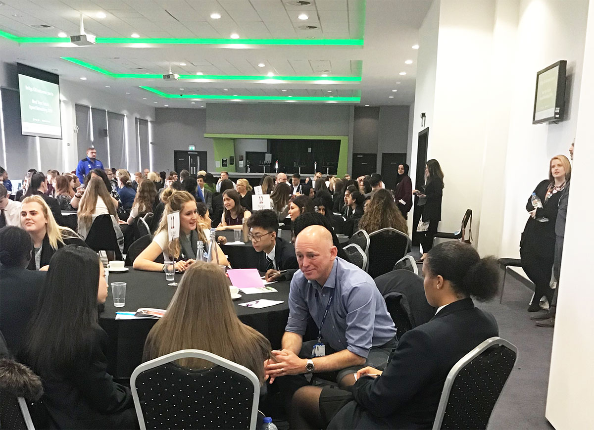 Students networking with professionals from a wide range of industries at the AJ Bell Stadium, as part of a Meet Your Futures event in June 2019